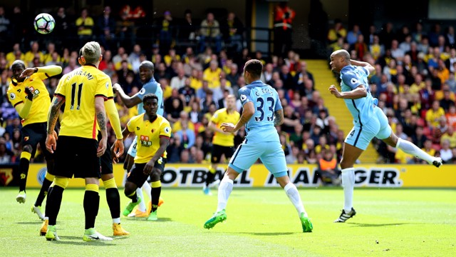 THUMPING HEADER: Kompany puts City ahead.