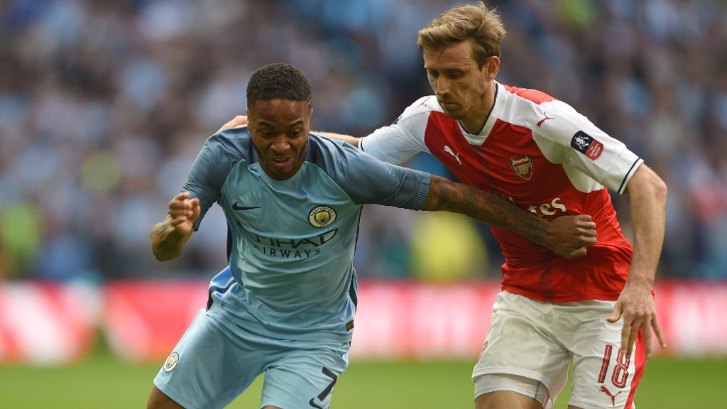 PACE: Sterling looks to burst away from Monreal.