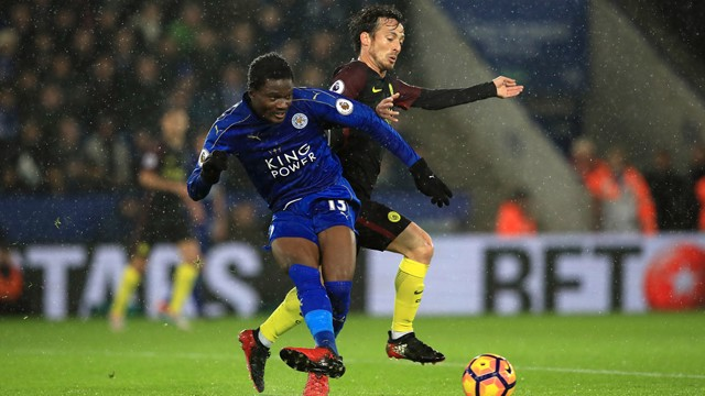 Leicester City's Daniel Amartey (left) and Manchester City's David Silva battle for the ball