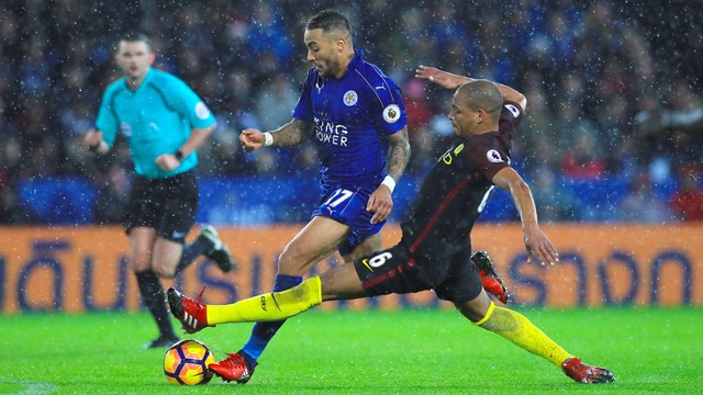 Leicester City's Danny Simpson (left) and Manchester City's Fernando battle for the ball