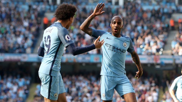 HIGH FIVE: Delph and Leroy Sane celebrate the former's goal.