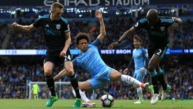 CHALLENGE: Leroy Sane attempts to win back possession
