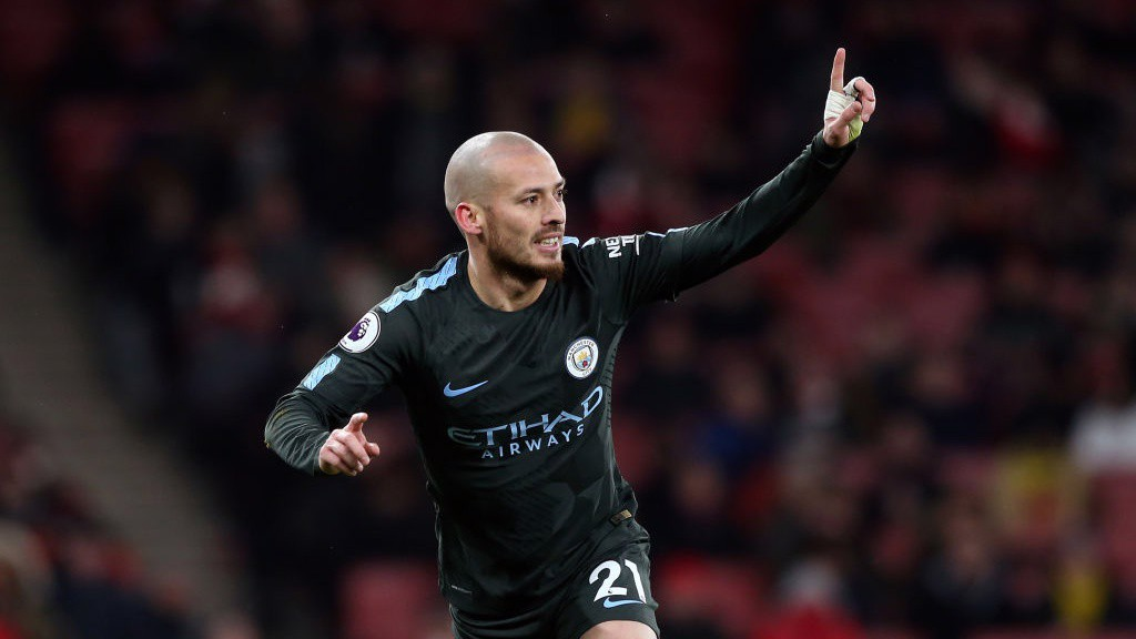 MAIN MAN: David Silva celebrate's as putting City two to the good.