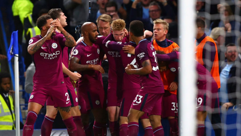 BLUE HEAVEN: The City players mob KDB after his stunning goal