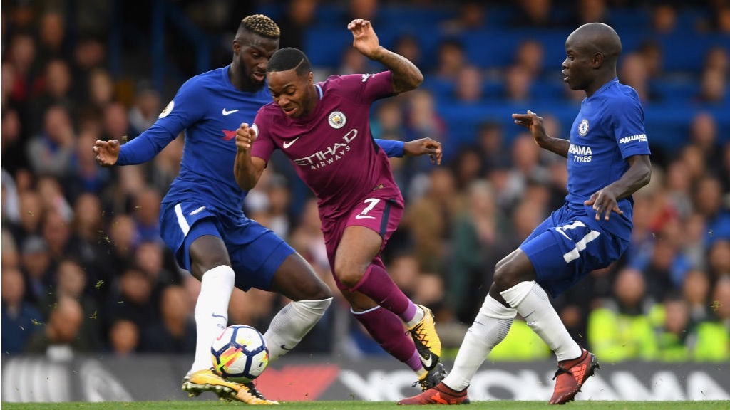 OUCH: Raheem Sterling is brought down by Tiemoue Bakayoko