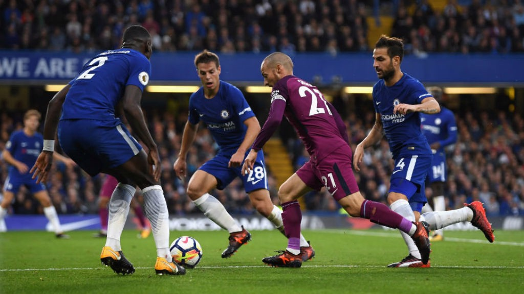 MAGIC TOUCH: David Silva creates havoc in the Chelsea defence