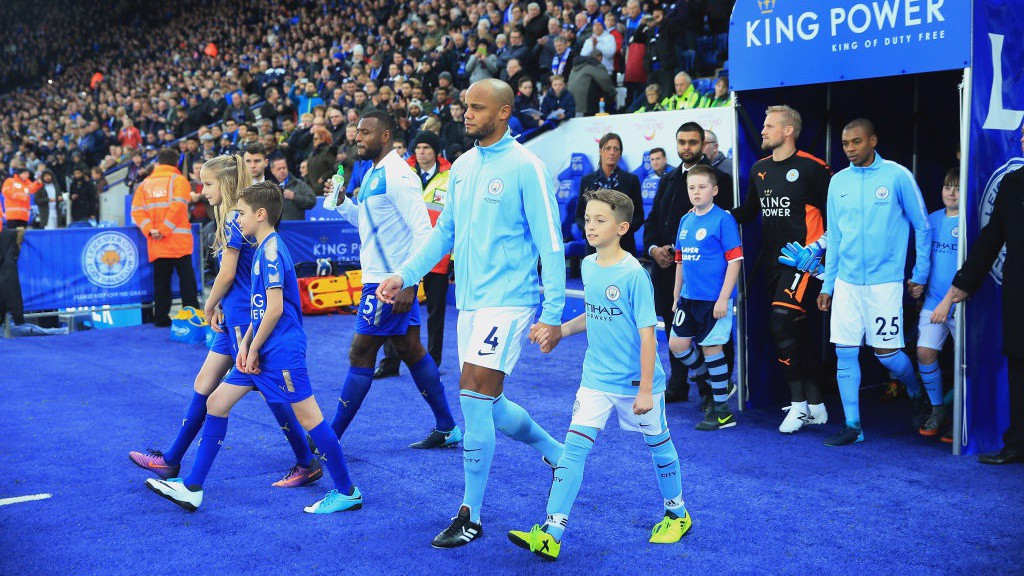 VINNIE RETURNS: City's captain Vincent Kompany leads the side out after a 14-game absence.