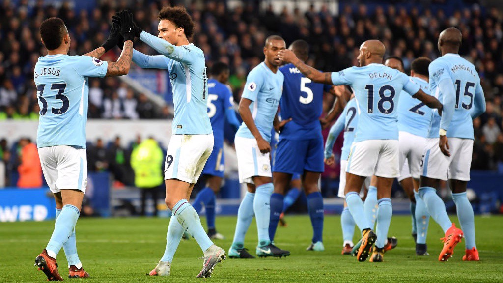COLLECTIVE: City's players celebrate a devastating team move.