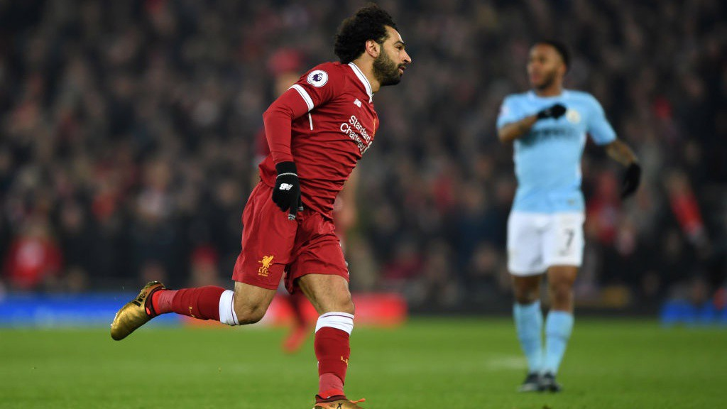BEHIND: Mo Salah wheels away after scoring Liverpool's fourth.
