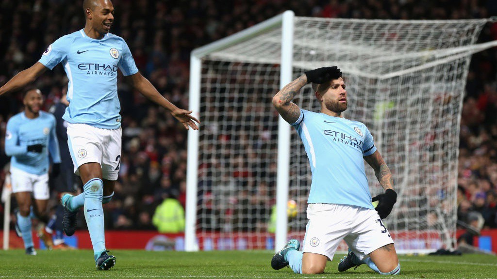 BACK IN FRONT: Nicolas Otamendi slides into his celebration after volleying City ahead at Old Trafford.