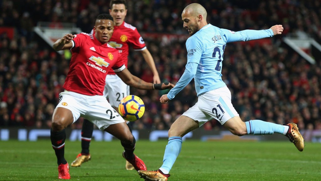 ON THE VOLLEY: David Silva takes aim in the first half at Old Trafford.