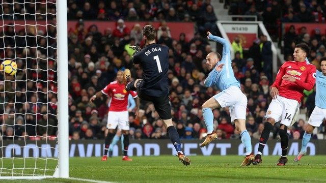 EL MAGO: David Silva puts City ahead in the 42nd minute at Old Trafford.