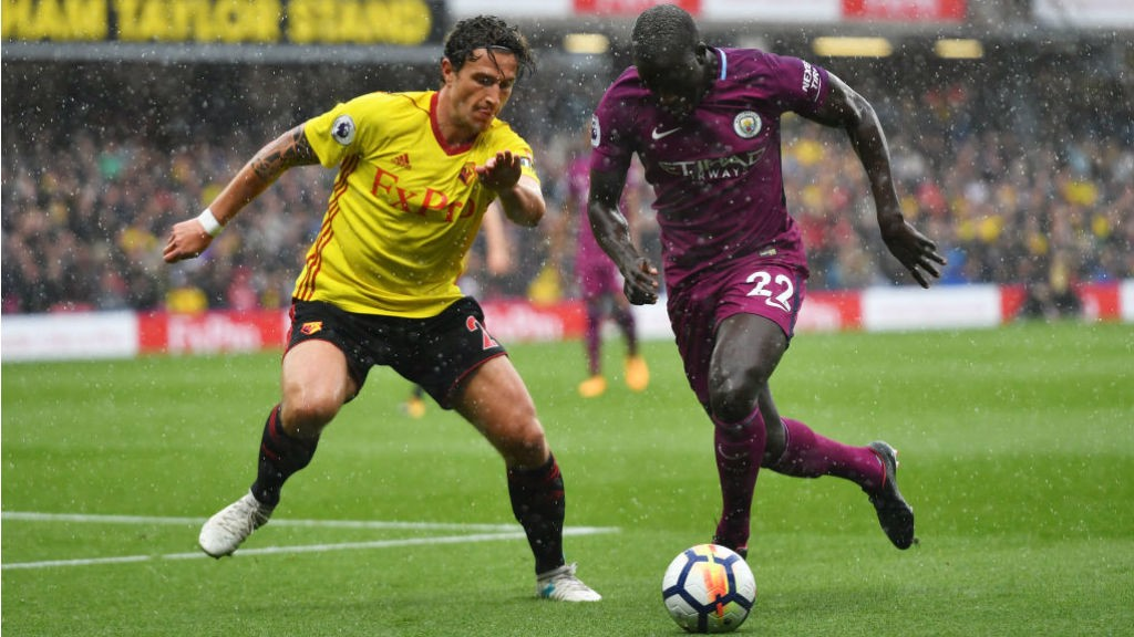 RAIN MAN: Benjamin Mendy drives through the rain to set up another City attack