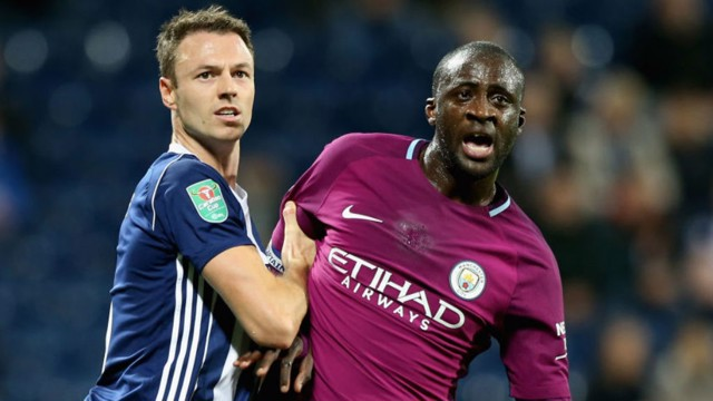 300 CLUB: Captain for the night Yaya Toure tussles with Jonny Evans