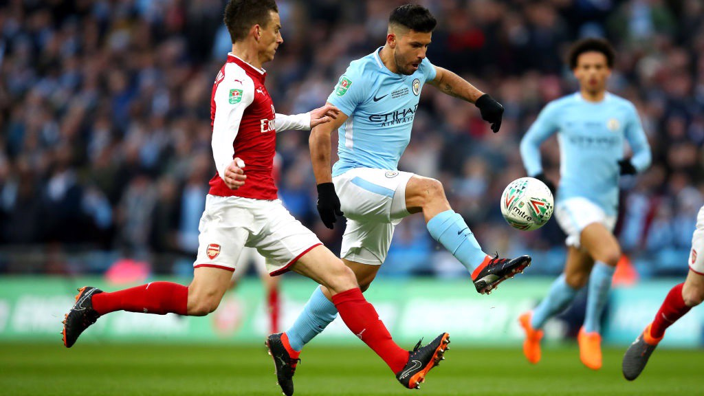 HIT MAN: Sergio Agüero lifts the ball over Arsenal's David Ospina to hand City the lead.