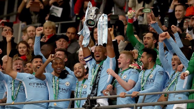 ​CHAMPIONS: Vincent Kompany lifts the Carabao Cup for the third time as City captain.