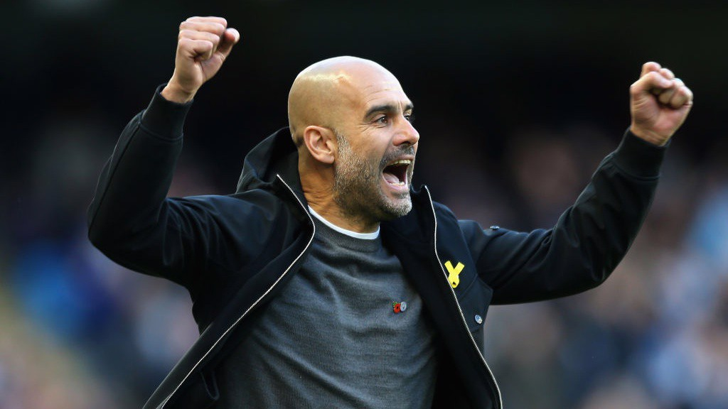 GUARDIOLA GLEE: The manager looked rather happy after his side's 50th goal of the season.