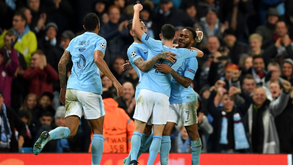 TOP SPOT: City players celebrate Sterling's winner