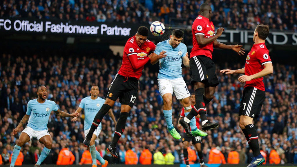 CLOSE: Sergio Agüero sees his headed effort saved by David De Gea.