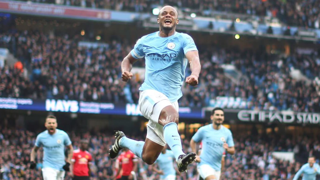 LEADER: Vincent Kompany powers City ahead.