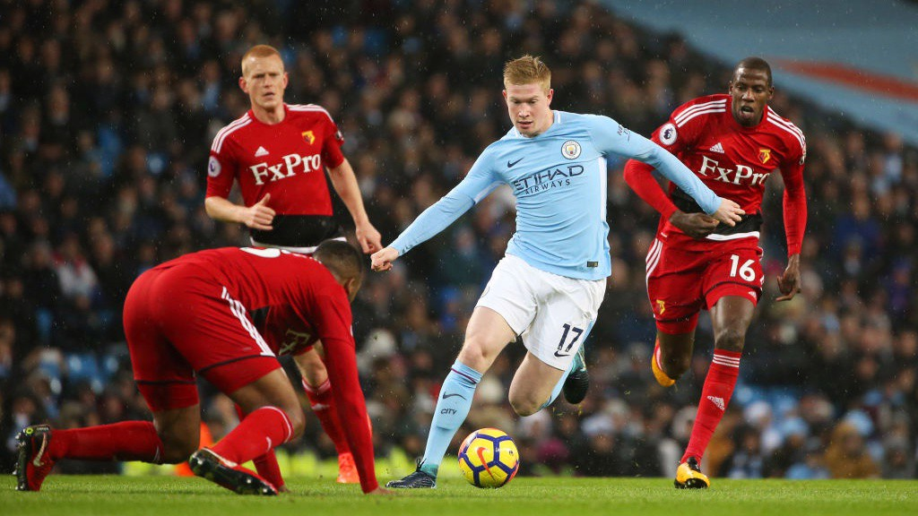 BELGIAN BRILLIANCE: Kevin De Bruyne dances past three Watford defenders.