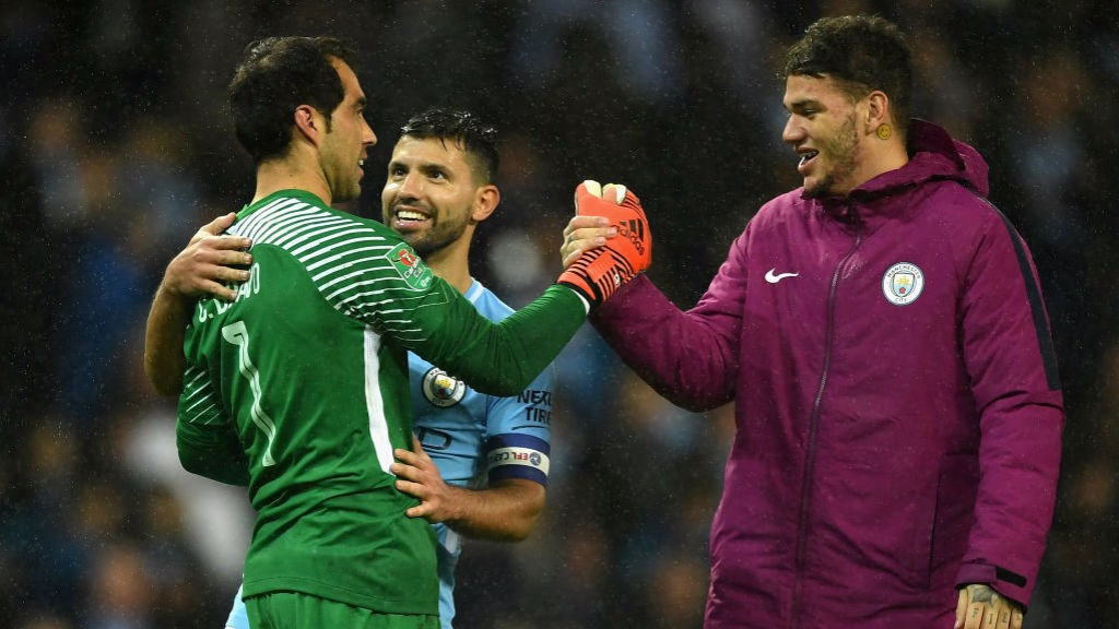 MAIN MAN: Sergio Aguero and Ederson congratulate Claudio Bravo.