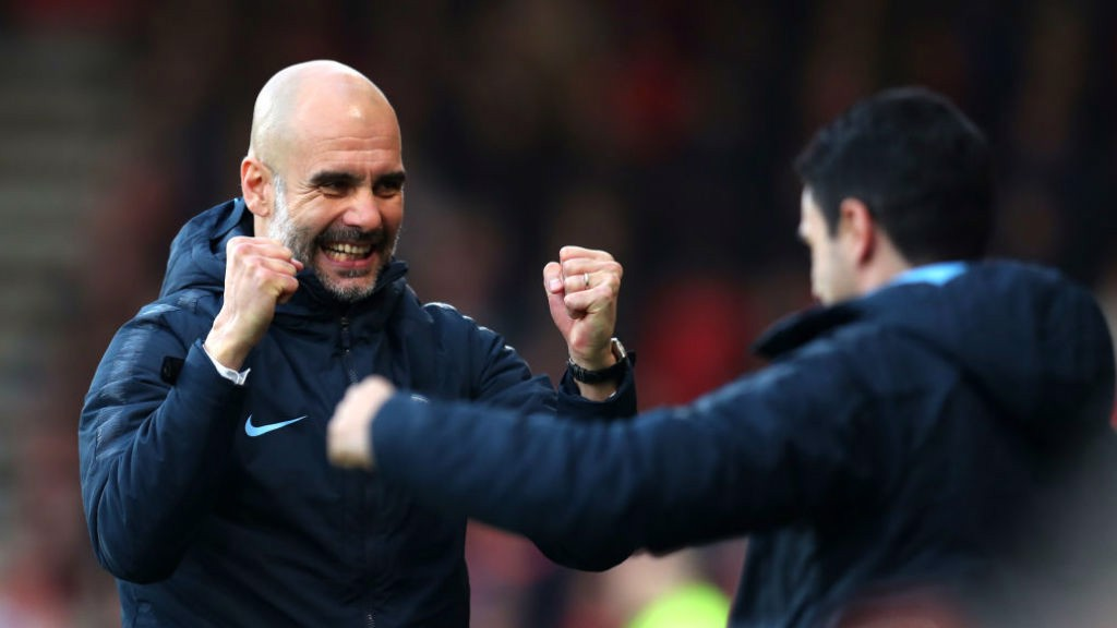 SMILES BETTER: Pep Guardiola celebrates our opener with Mikel Arteta