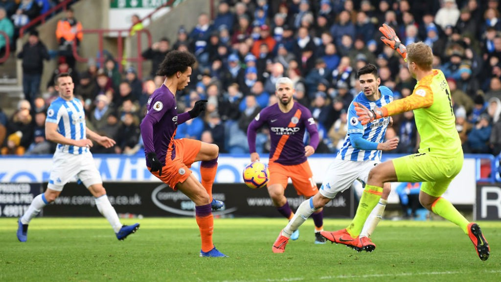 THREE CHEERS: Leroy Sane finishes off a superb move to register our third goal