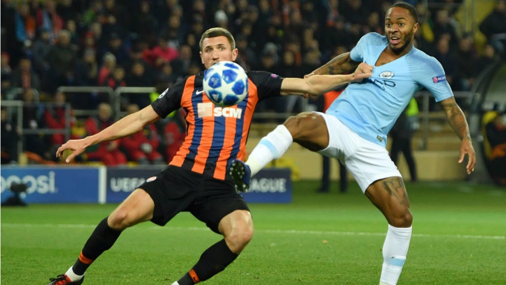 GETTING SHIRTY: Raheem Sterling fends off attention from the Shakhtar defence