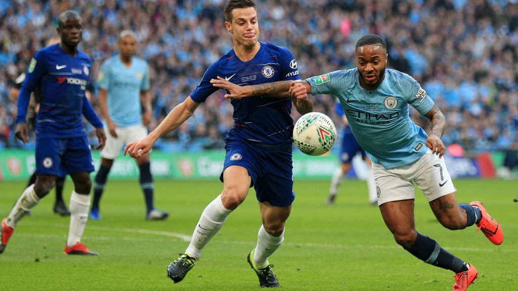 ACTION STATIONS: Raheem Sterling looks to fend off Cesar Azpilicueta