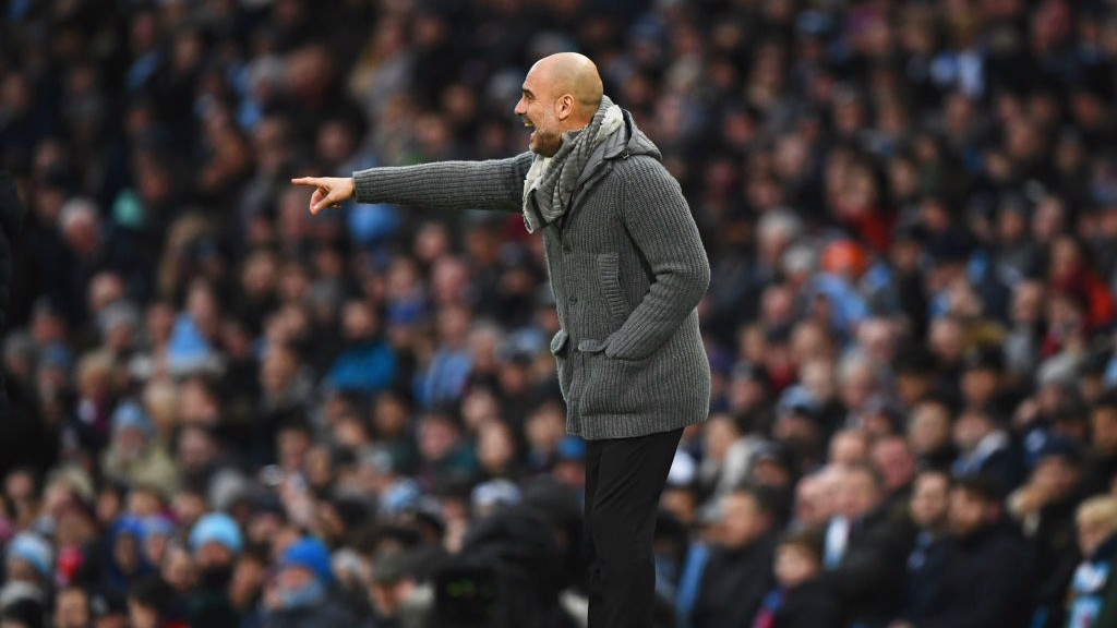 MASTER AT WORK: Pep Guardiola dishes out the orders.