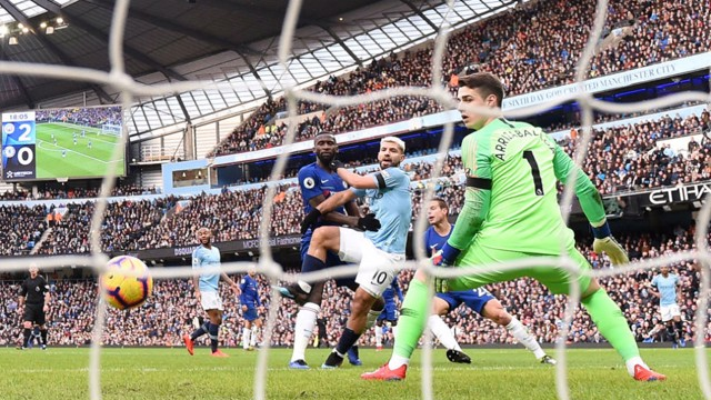 RAMPANT: Aguero slots his side's third goal of the game past Kepa in the Chelsea goal.