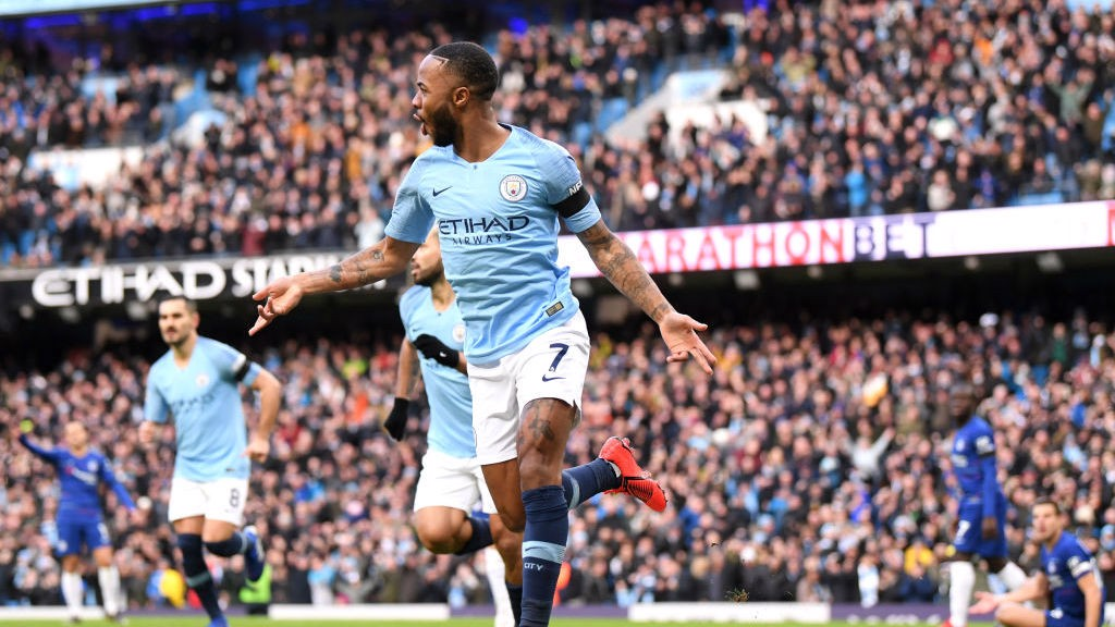 QUICK FIRE: Raheem sterling wheels away after firing City into an early lead.