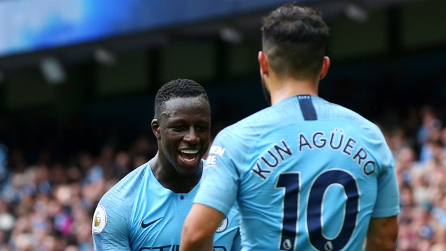 MERCI, MENDY!: Sergio Aguero thanks Benjamin Mendy for his assist, having completed his hat-trick with a glorious flick