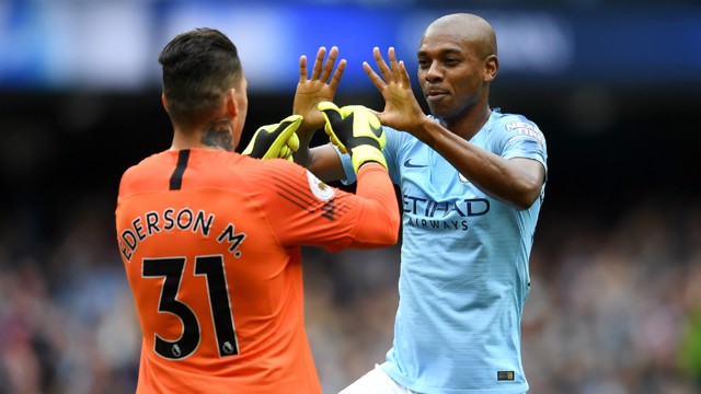 HE'S A KEEPER: Fernandinho congratulates Ederson on his outrageous assist - City's first created by a goalkeeper in the Premier League!
