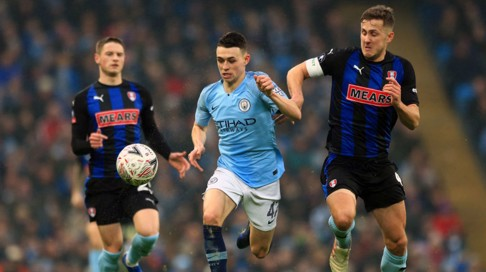 TEEN SPIRIT: Phil Foden takes the fight to the Rotherham back-line
