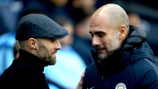 SHAKE ON IT: Pep Guardiola greets Rotherham counterpart Paul Warne