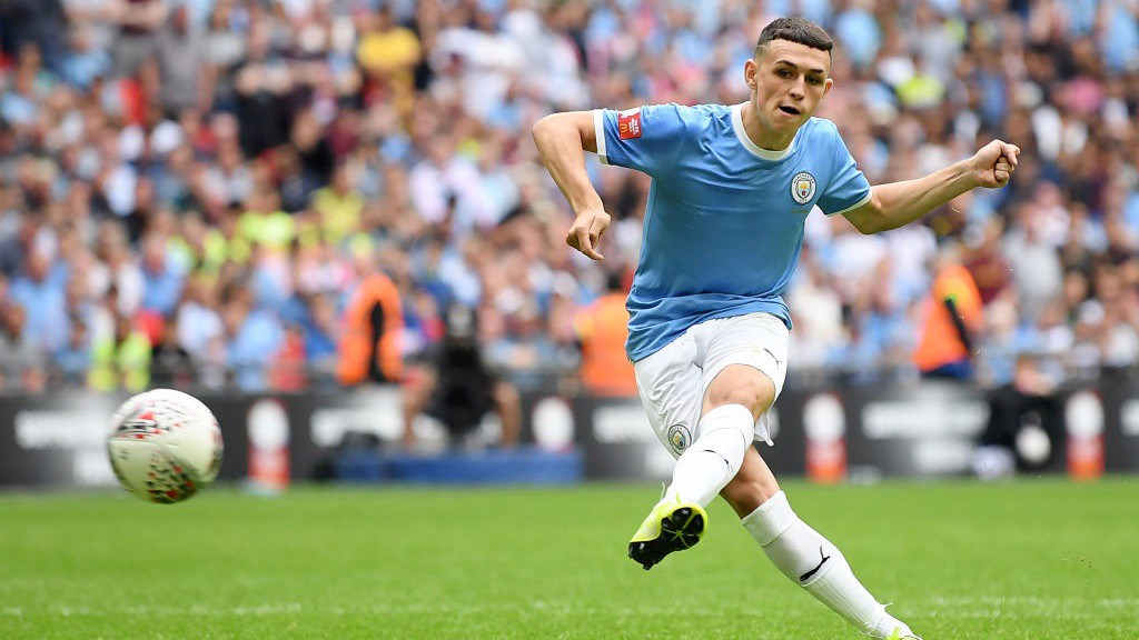 UNFAZED: Phil Foden made no mistake from the spot.