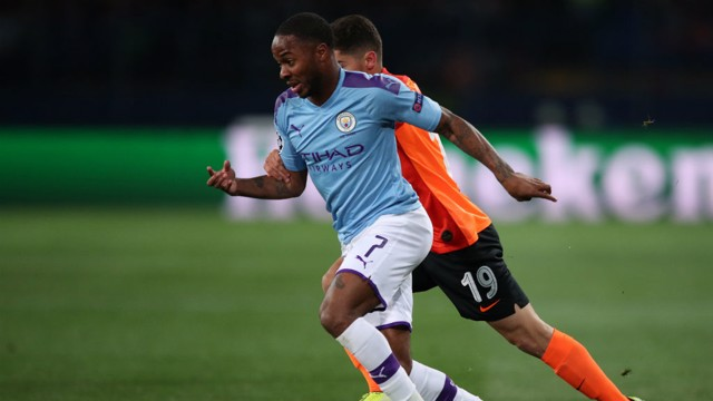 ON THE MARCH: Raheem Sterling takes on the Shakhtar defence