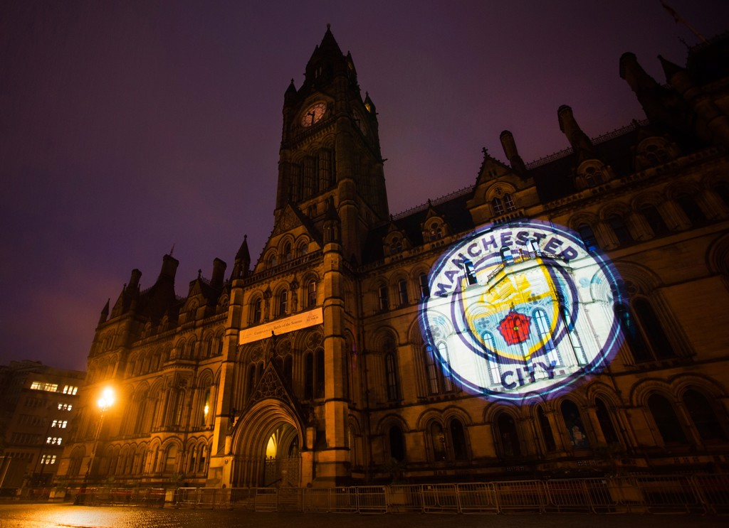 Manchester Town Hall: The all new Manchester City badge lights up the Manchester Town Hall