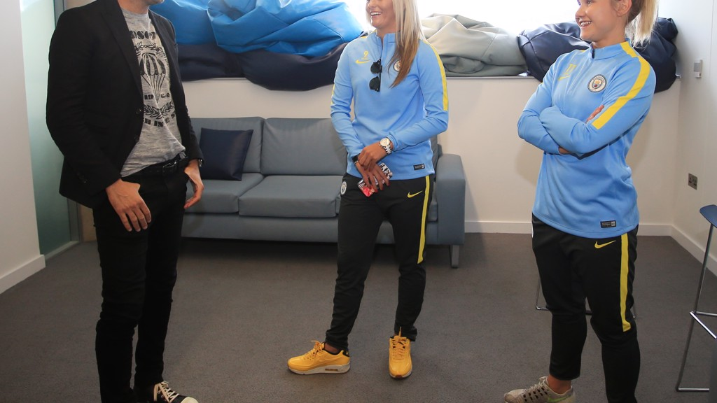 Pep shares a laugh with MCWFC stars Toni Duggan and Izzy Christiansen before taking the stage for Cityzens Weekend