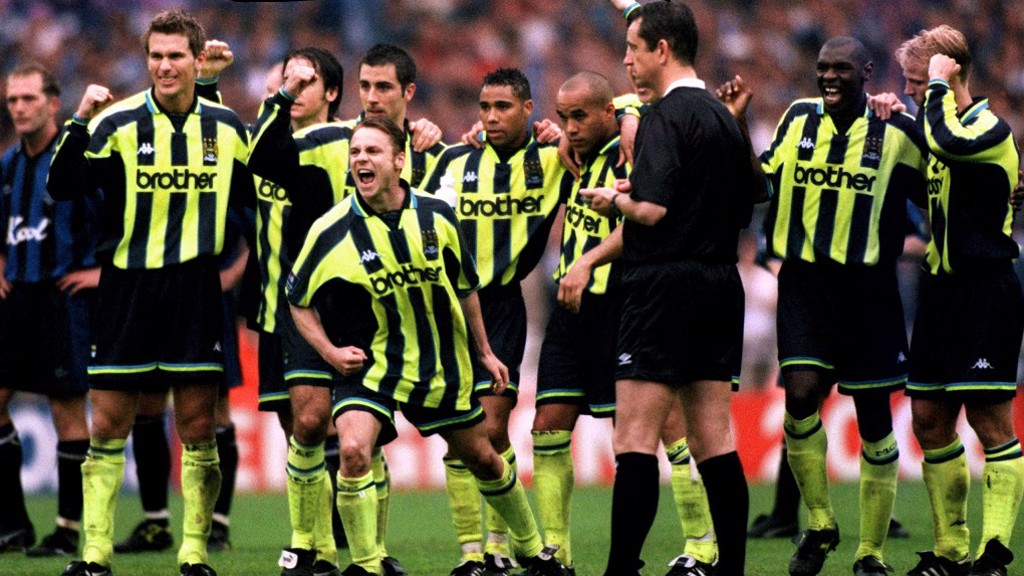 SPOT ON! Paul Dickov and team-mates celebrate a penalty shoot-out goal against Gillingham