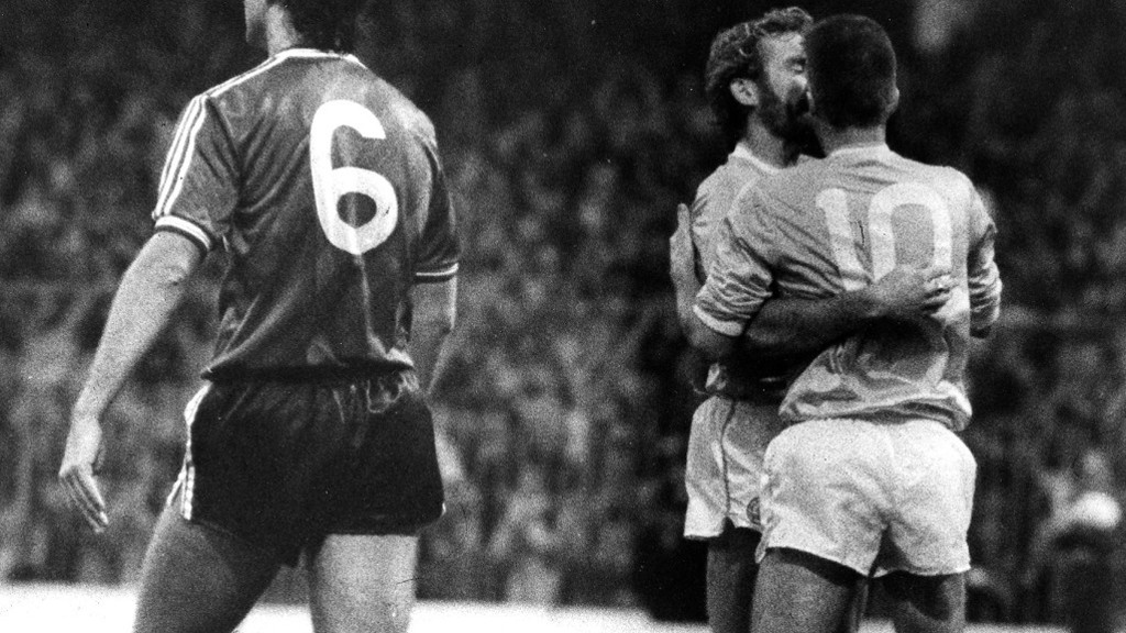 Moulden (No.10) is congratulated by Tony Grealish after another goal