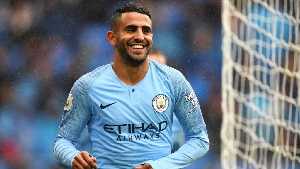 TARGET MAN: Riyad Mahrez is all smiles after scoring his first goal for City in our 5-0 win at Cardiff last month